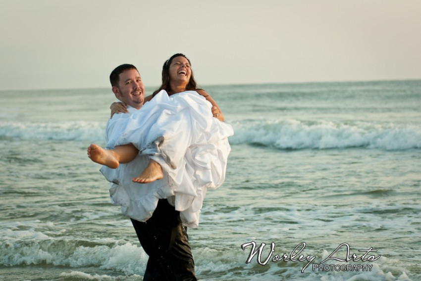 carrying bride into the ocean