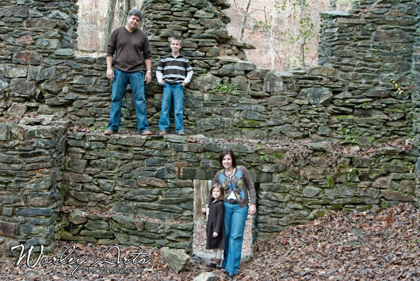 family on old stone wall