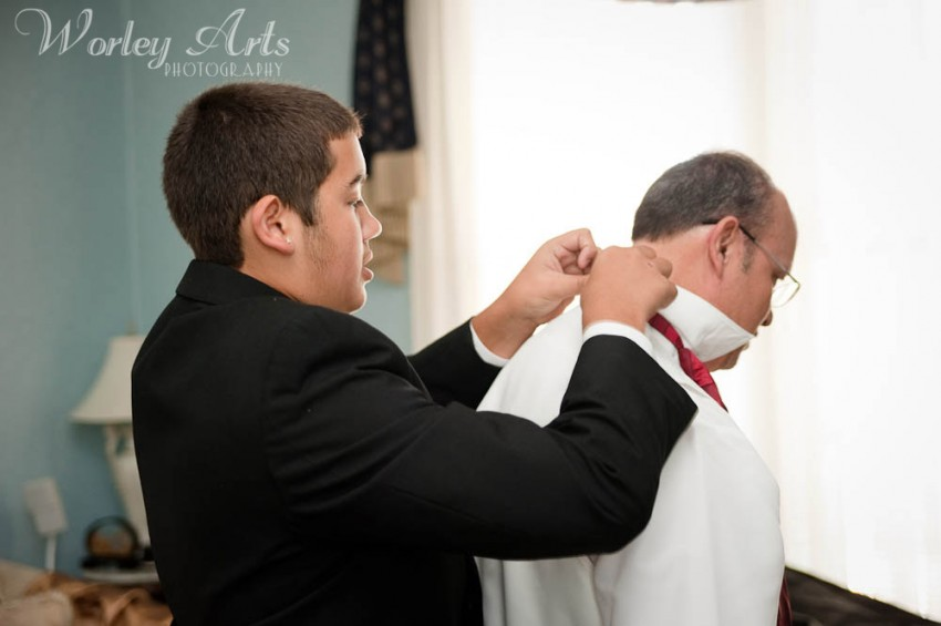 son helps groom get ready