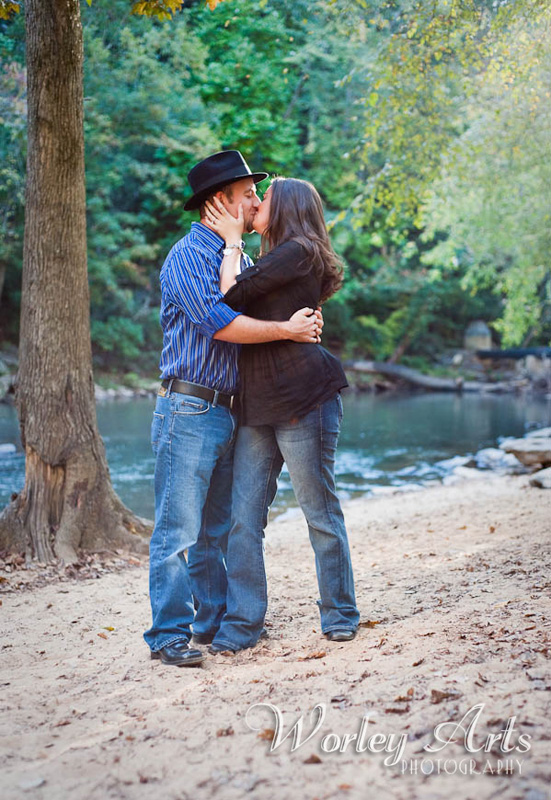 engagement session couple river kissing
