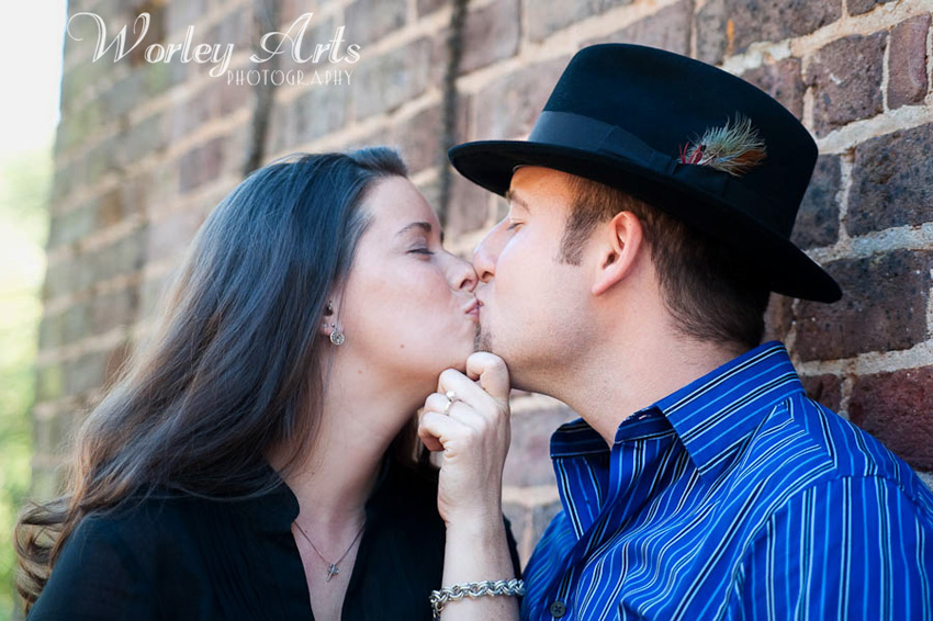engagement session couple brick building kisses