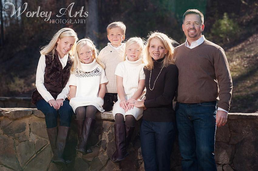 family on stone wall