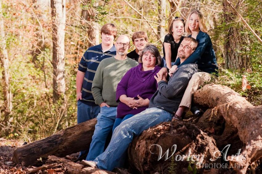family sitting on fallen tree