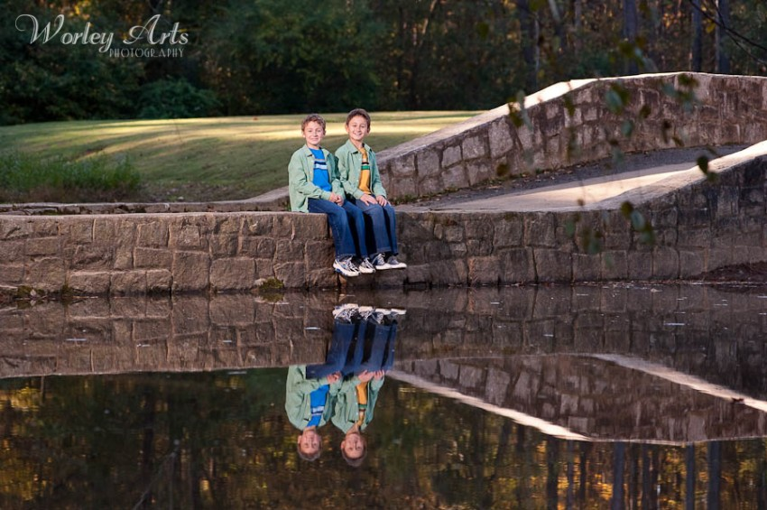 boys on bridge reflection