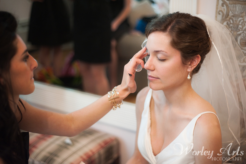 bridesmaid applying make-up